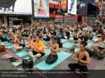 people participate in a yoga class during 4