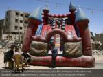 children play inside an inflatable castle during