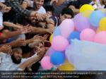 egyptians celebrate and try to catch balloons