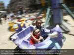 girls play at a makeshift amusement park during