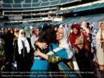 muslim women hug as they gather
