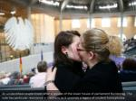 an unidentified couple kisses after a session