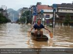 a man makes his way with a wooden boat through