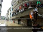 rescuers transfer residents with a boat