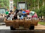 students are transferred by a forklift through