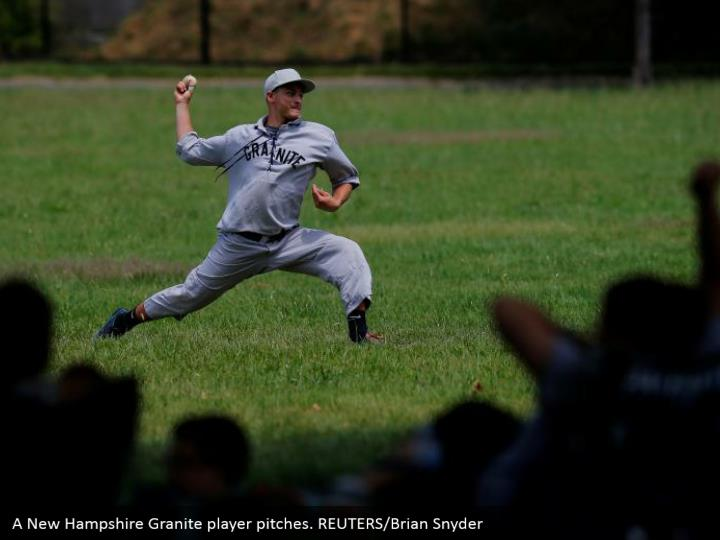 A New Hampshire Granite player pitches. REUTERS/Brian Snyder