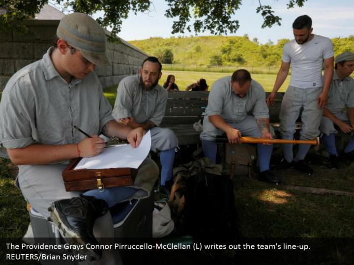 The Providence Grays Connor Pirruccello-McClellan (L) writes out the team's line-up.   REUTERS/Brian Snyder