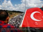 a man waves turkey s national flag as supporters