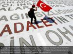 a young man walks with a turkish national flag