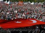 people carry a huge turkish flag during a rally