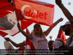 people wave turkish flags during a rally to mark 2