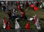 people wave turkish flags during a rally to mark 3