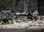 a burned recreational vehicle sits on a property