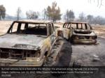 burned vehicles lie in a field after the whittier