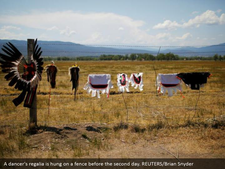 A dancer's regalia is hung on a fence before the second day. REUTERS/Brian Snyder