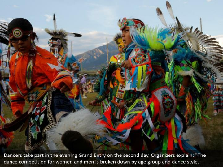 """Dancers take part in the evening Grand Entry on the second day. Organizers explain: """"The dance competition for women and men is broken down by age group and dance style."""