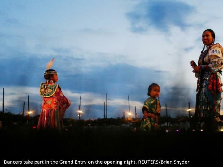 Dancers take part in the Grand Entry on the opening night. REUTERS/Brian Snyder