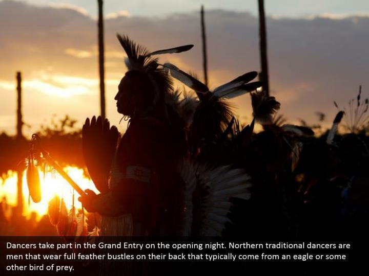 Dancers take part in the Grand Entry on the opening night. Northern traditional dancers are men that wear full feather bustles on their back that typically come from an eagle or some other bird of prey.