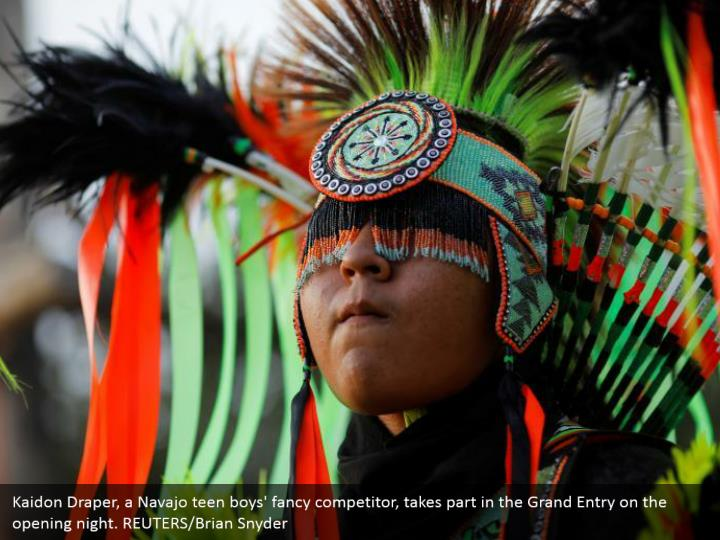 Kaidon Draper, a Navajo teen boys' fancy competitor, takes part in the Grand Entry on the opening night. REUTERS/Brian Snyder