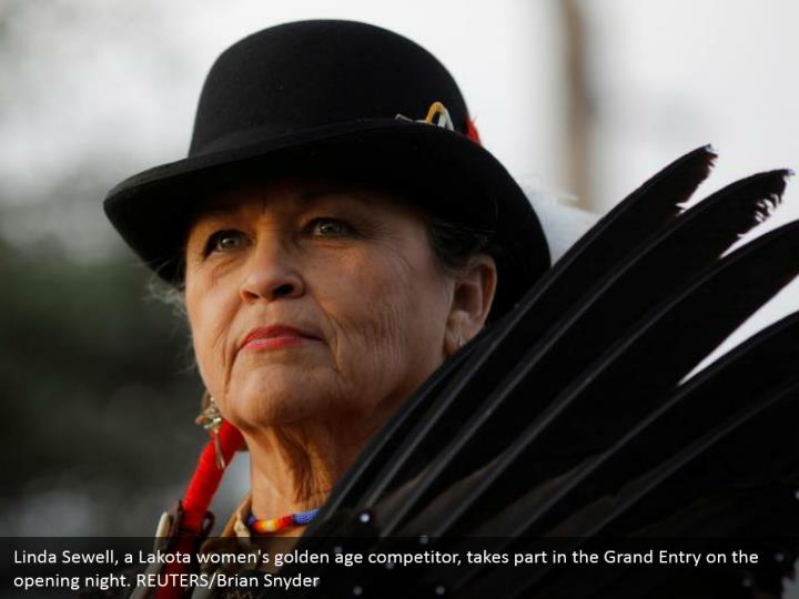 Linda Sewell, a Lakota women's golden age competitor, takes part in the Grand Entry on the opening night. REUTERS/Brian Snyder