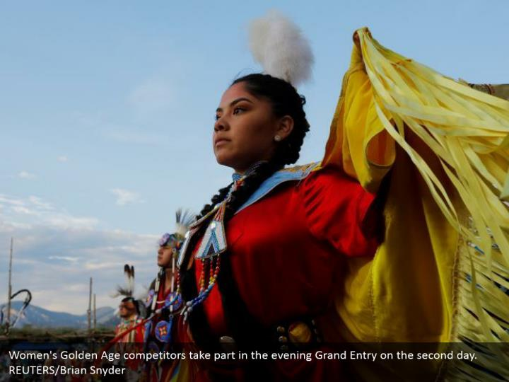 Women's Golden Age competitors take part in the evening Grand Entry on the second day. REUTERS/Brian Snyder