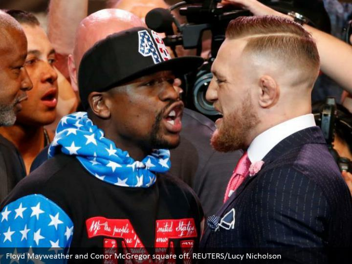 Floyd Mayweather and Conor McGregor square off. REUTERS/Lucy Nicholson