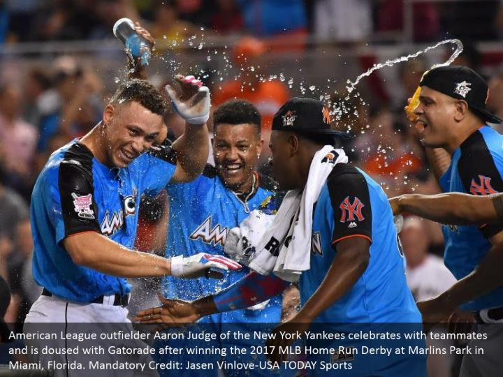 American League outfielder Aaron Judge of the New York Yankees celebrates with teammates and is doused with Gatorade after winning the 2017 MLB Home Run Derby at Marlins Park in Miami, Florida. Mandatory Credit: Jasen Vinlove-USA TODAY Sports