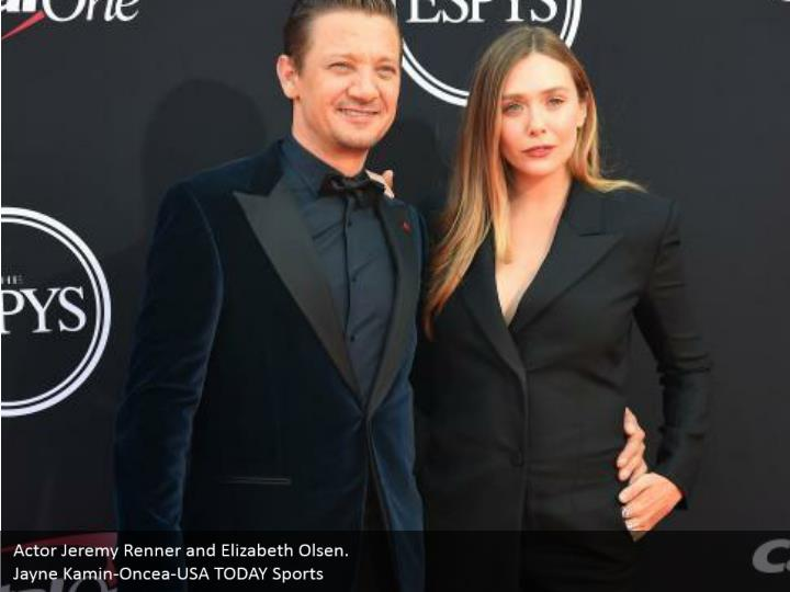 Actor Jeremy Renner and Elizabeth Olsen.  Jayne Kamin-Oncea-USA TODAY Sports