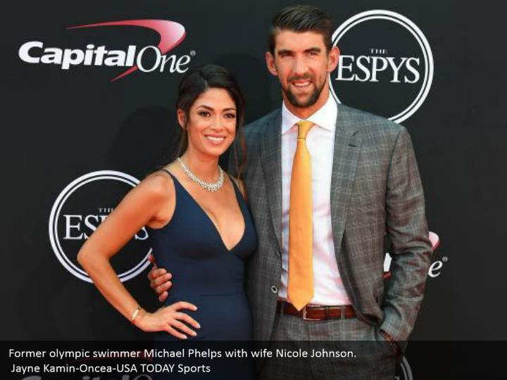 Former olympic swimmer Michael Phelps with wife Nicole Johnson.  Jayne Kamin-Oncea-USA TODAY Sports