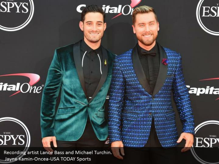 Recording artist Lance Bass and Michael Turchin.  Jayne Kamin-Oncea-USA TODAY Sports