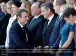 french president emmanuel macron l greets former
