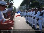 people look at the parade of french navy soldiers