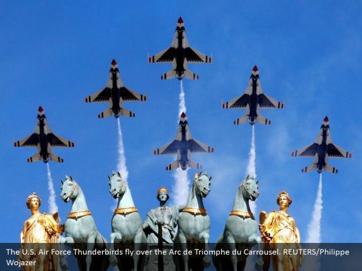 The U.S. Air Force Thunderbirds fly over the Arc de Triomphe du Carrousel. REUTERS/Philippe Wojazer