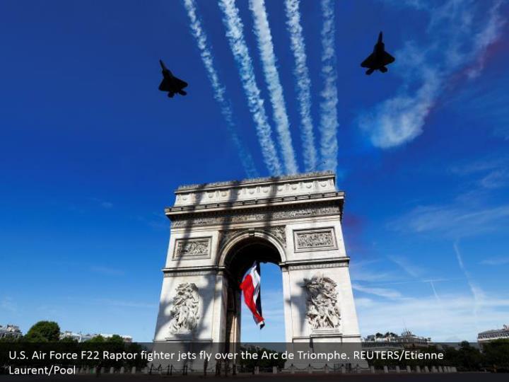 U.S. Air Force F22 Raptor fighter jets fly over the Arc de Triomphe. REUTERS/Etienne Laurent/Pool