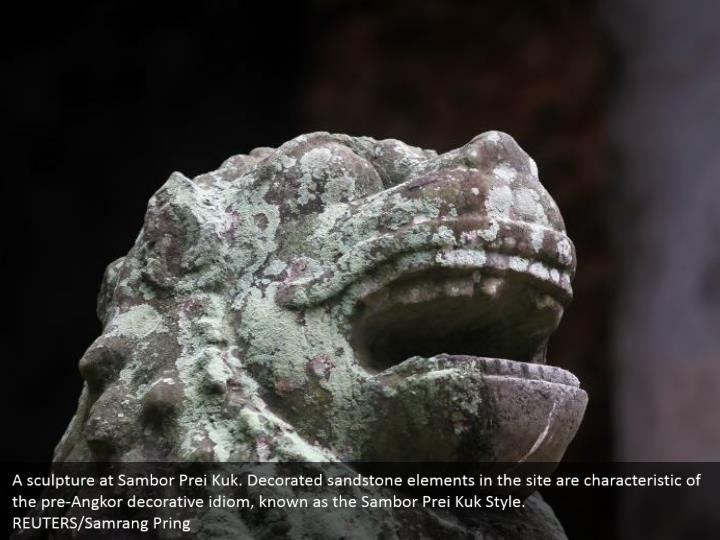 A sculpture at Sambor Prei Kuk. Decorated sandstone elements in the site are characteristic of the pre-Angkor decorative idiom, known as the Sambor Prei Kuk Style.  REUTERS/Samrang Pring