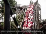 people dressed as santa claus ride a roller