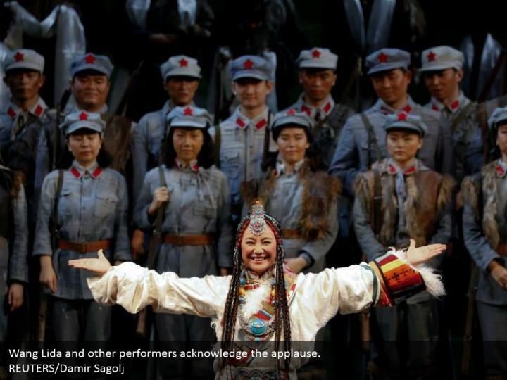 Wang Lida and other performers acknowledge the applause.  REUTERS/Damir Sagolj