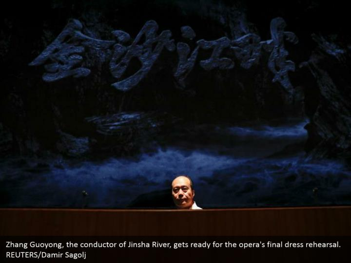 Zhang Guoyong, the conductor of Jinsha River, gets ready for the opera's final dress rehearsal. REUTERS/Damir Sagolj