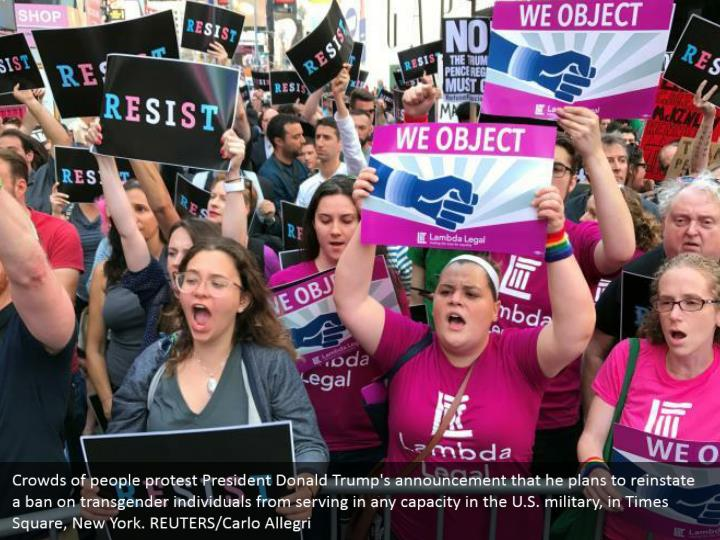 Crowds of people protest President Donald Trump's announcement that he plans to reinstate a ban on transgender individuals from serving in any capacity in the U.S. military, in Times Square, New York. REUTERS/Carlo Allegri