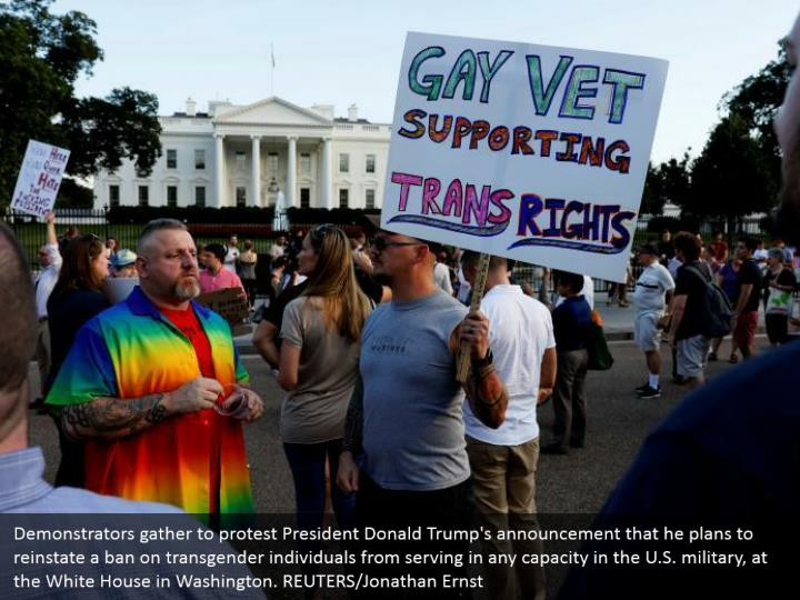 Demonstrators gather to protest President Donald Trump's announcement that he plans to reinstate a ban on transgender individuals from serving in any capacity in the U.S. military, at the White House in Washington. REUTERS/Jonathan Ernst