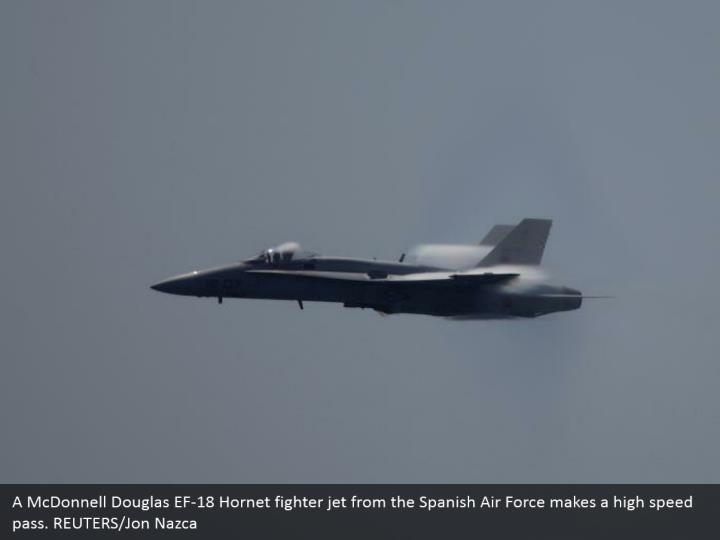 A McDonnell Douglas EF-18 Hornet fighter jet from the Spanish Air Force makes a high speed pass. REUTERS/Jon Nazca