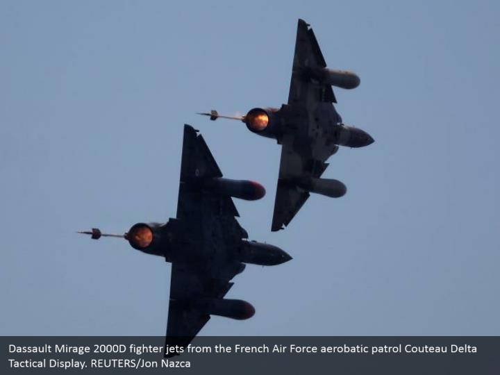 Dassault Mirage 2000D fighter jets from the French Air Force aerobatic patrol Couteau Delta Tactical Display. REUTERS/Jon Nazca