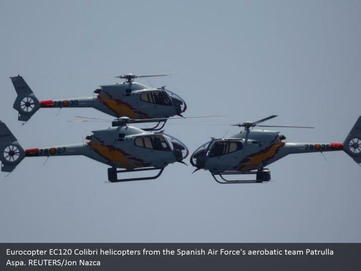 Eurocopter EC120 Colibri helicopters from the Spanish Air Force's aerobatic team Patrulla Aspa. REUTERS/Jon Nazca
