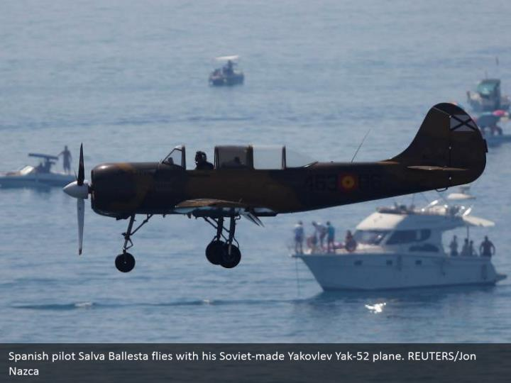 Spanish pilot Salva Ballesta flies with his Soviet-made Yakovlev Yak-52 plane. REUTERS/Jon Nazca
