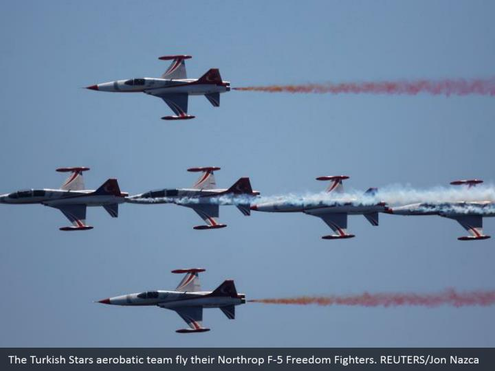 The Turkish Stars aerobatic team fly their Northrop F-5 Freedom Fighters. REUTERS/Jon Nazca