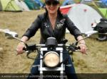 a woman poses with her motorbike reuters stefanie