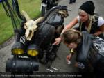 participants prepare their motorbikes for a ride