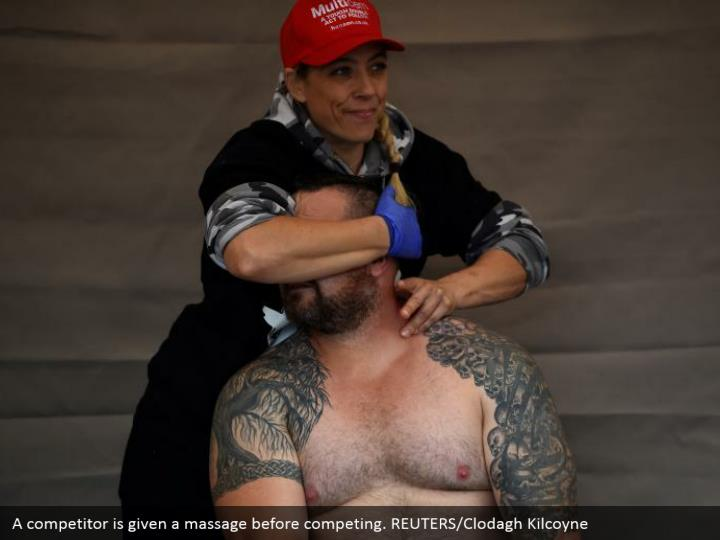 A competitor is given a massage before competing. REUTERS/Clodagh Kilcoyne