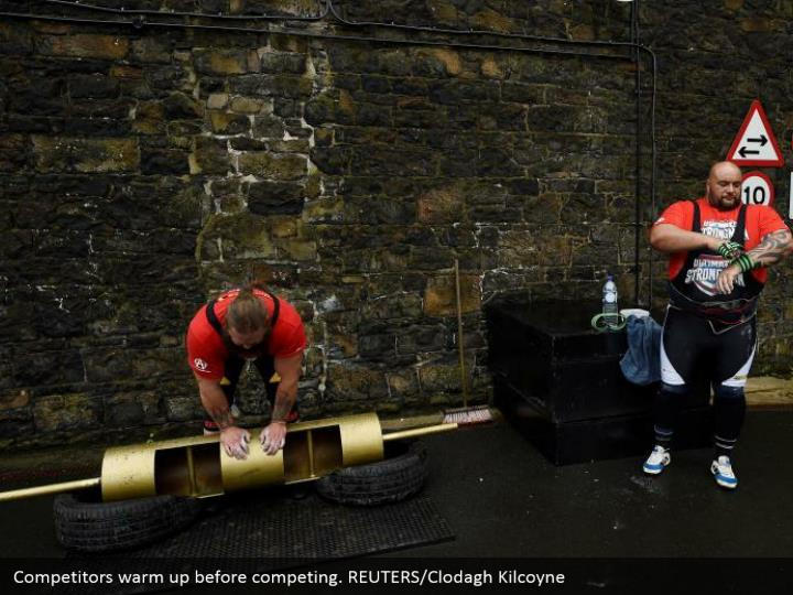 Competitors warm up before competing. REUTERS/Clodagh Kilcoyne