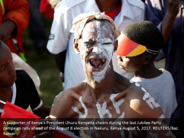 A supporter of Kenya's President Uhuru Kenyatta cheers during the last Jubilee Party campaign rally ahead of the August 8 election in Nakuru, Kenya August 5, 2017. REUTERS/Baz Ratner